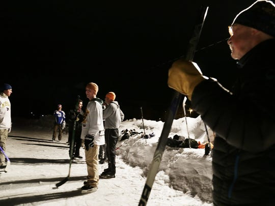 "Chip Truscon, 68, of Marquette asks to join in with Pond Hockey Marquette near downtown Marquette. ""I really want to ask them if I can play, I am dying to,"" said Truscon as he worked up the nerve to join in."