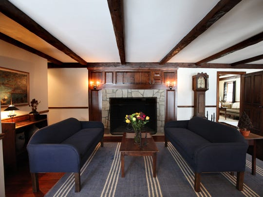 Family room with natural fireplace and beamed ceilings.