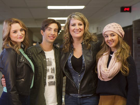 "Amy S. Weber, third from left, with ""A Girl Like Her"" cast members Hunter King, Jimmy Bennett and Lexi Ainsworth. The film was shot at metro Detroit locations, including Seaholm High School in Birmingham."
