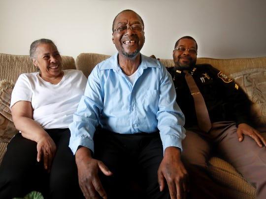 John Payne, 67, of Southgate, center, with his wife,