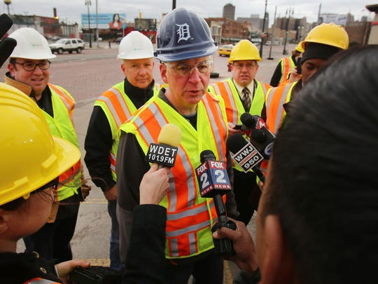 Gov. Rick Snyder speaks to the media after his pothole-patching turn with MDOT workers along Michigan Avenue on Thursday, April 23, 2015, in Detroit.