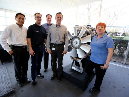 Detroit Diesel is the 2015 Green Leaders  large company winner. Left to right is  John Wu, facility and energy manager; Carlo Caltagirone, energy specialist; Del Spooner, technical service director; Jeff Allen, plant manager, and Karen Goryl,  environmental engineer.