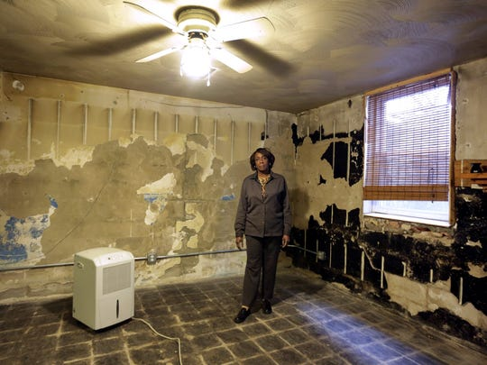 Odessa Willis in the basement of her Detroit home on