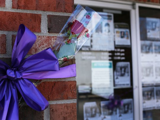 A fresh rose has been placed in the front of the former search command center for the missing Maybee, Mich. young woman Chelsea Bruck at a former Monroe Bank and Trust in Newport, Mich. Sunday, April 26, 2015. Bruck had been missing for six months since she attended a Halloween party in Frenchtown Township. Her remains were discovered Friday in Carleton, Mich. and positively identified yesterday.