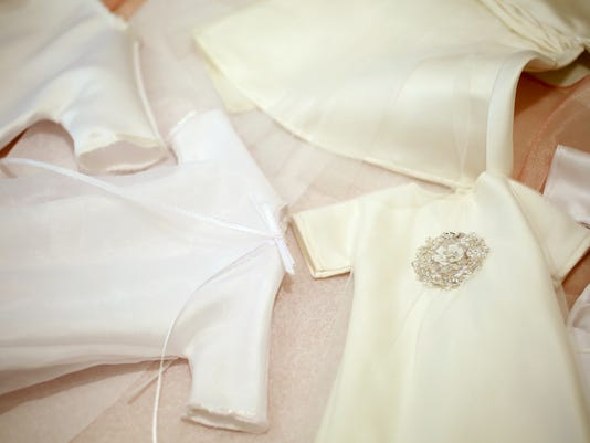 Wedding gowns turned into \'angel gowns\' for babies