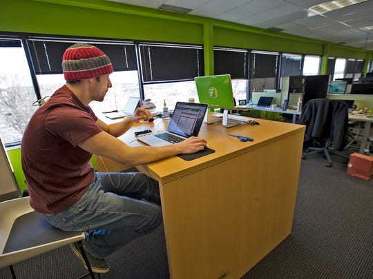Lance Padgett works on his computer at Formstack, a growing software development company, Tuesday, Jan. 13, 2015.