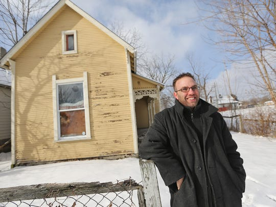 Chad Lethig, Indianapolis Preservation Coordinator with Indiana Landmarks, stands outside the tiny house on Station St. near Martin University, Friday, January 9, 2015.