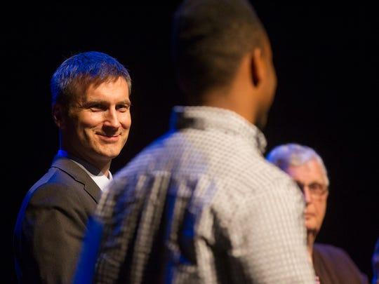 Iowa City Mayor Matt Hayek applauds a student during the 2014 Youth Awards at the Englert Theatre on Wednesday, May 14, 2014.   David Scrivner / Iowa City Press-Citizen