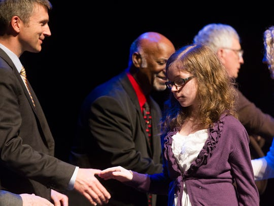 South East Junior High student Rachel Thorpe is recognized Wednesday at the 2014 Youth Awards at The Englert Theatre.