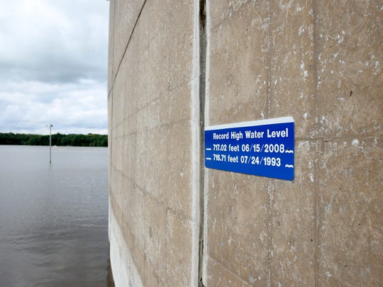 In this file photo from 2013, a sign marks the peak water levels during the 1993 and 2008 flood above the spillway at the Coralville Dam.