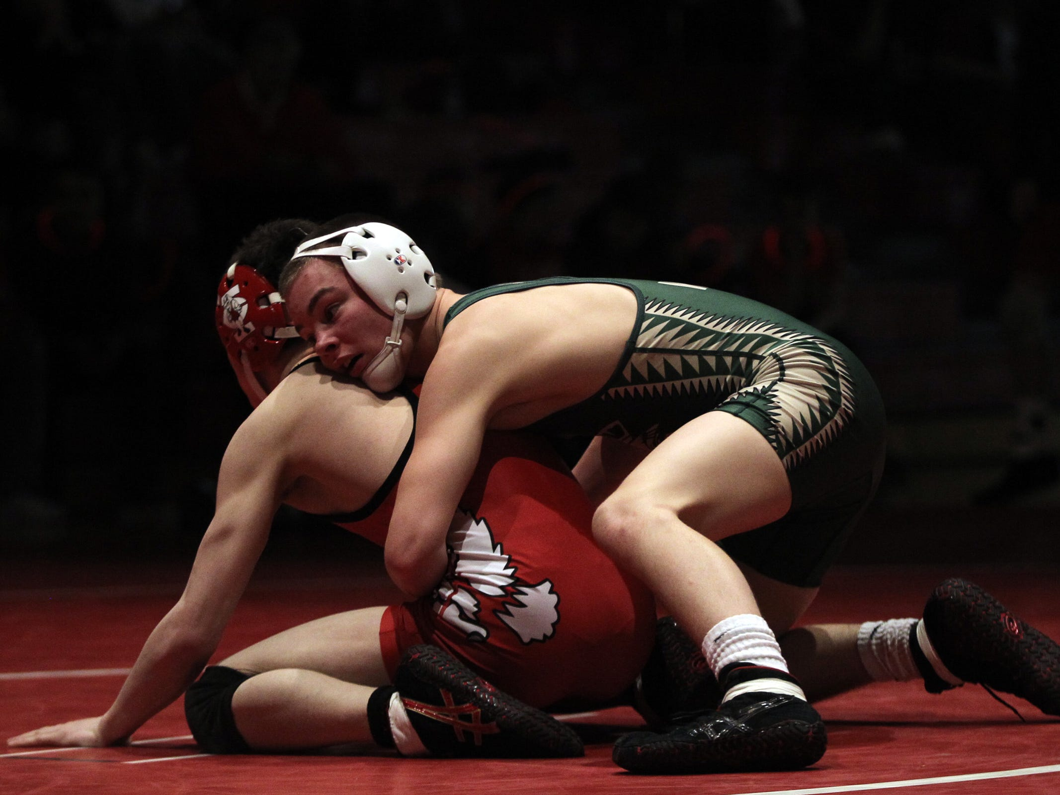 West High's Tanner Rohweder, top, wrestles City High's Griffin Benge last year. Rohweder is a four-time state qualifier and already has three state medals. He wants to go out on top this week.