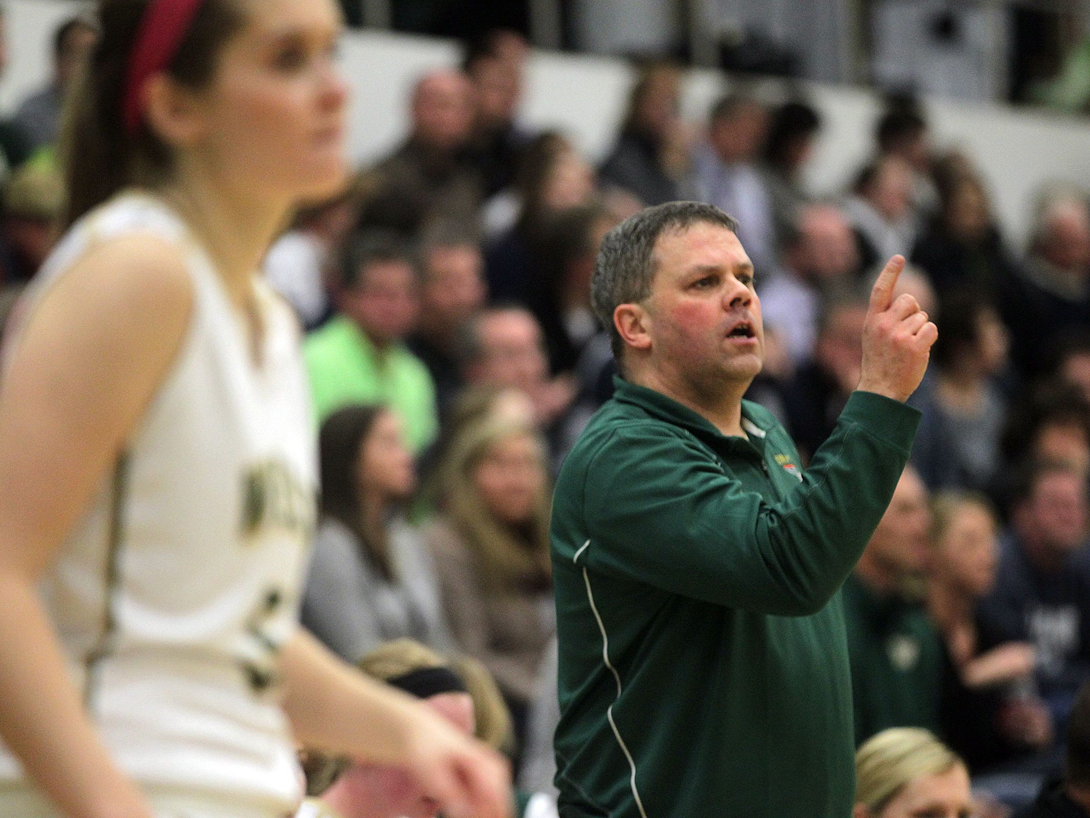 West High head coach BJ Mayer calls to players during the Women of Troy's Class 5A regional final against Pleasant Valley on Tuesday, Feb. 24, 2015. West High won, 45-27, to advance to the state tournament. David Scrivner / Iowa City Press-Citizen