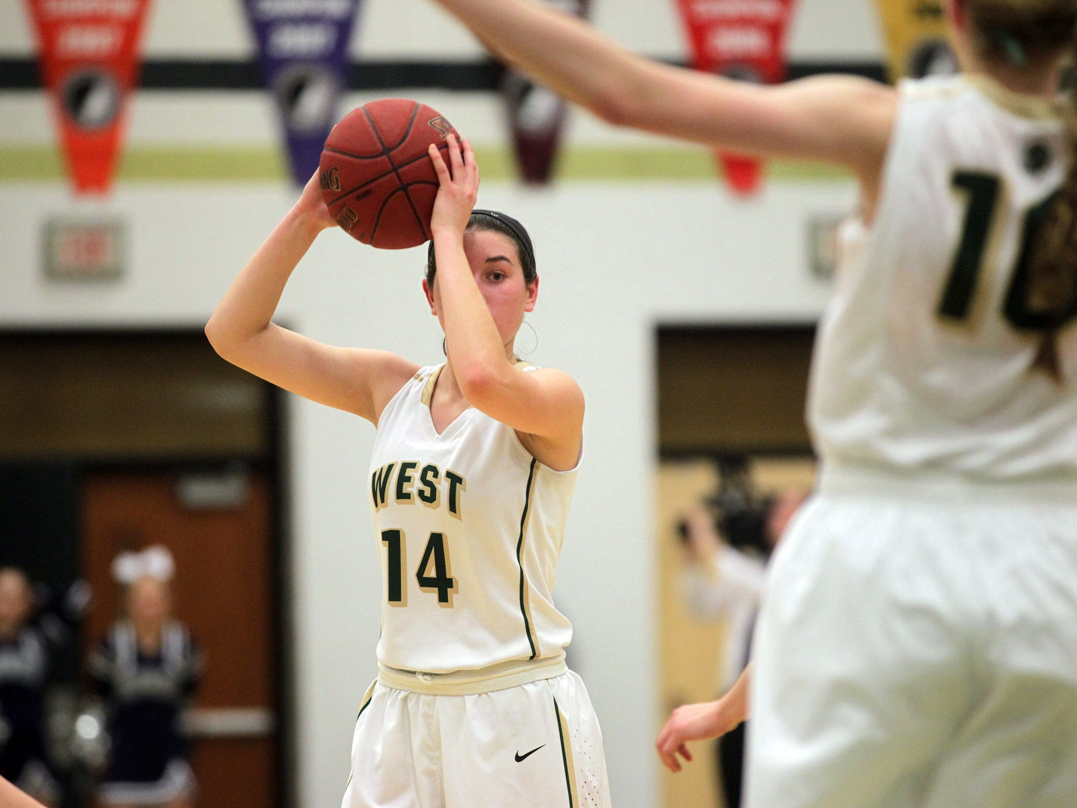 West High's Dani Craig looks for an open teammate during the Women of Troy's Class 5A regional final against Pleasant Valley on Tuesday, Feb. 24, 2015. West High won, 45-27, to advance to the state tournament. David Scrivner / Iowa City Press-Citizen