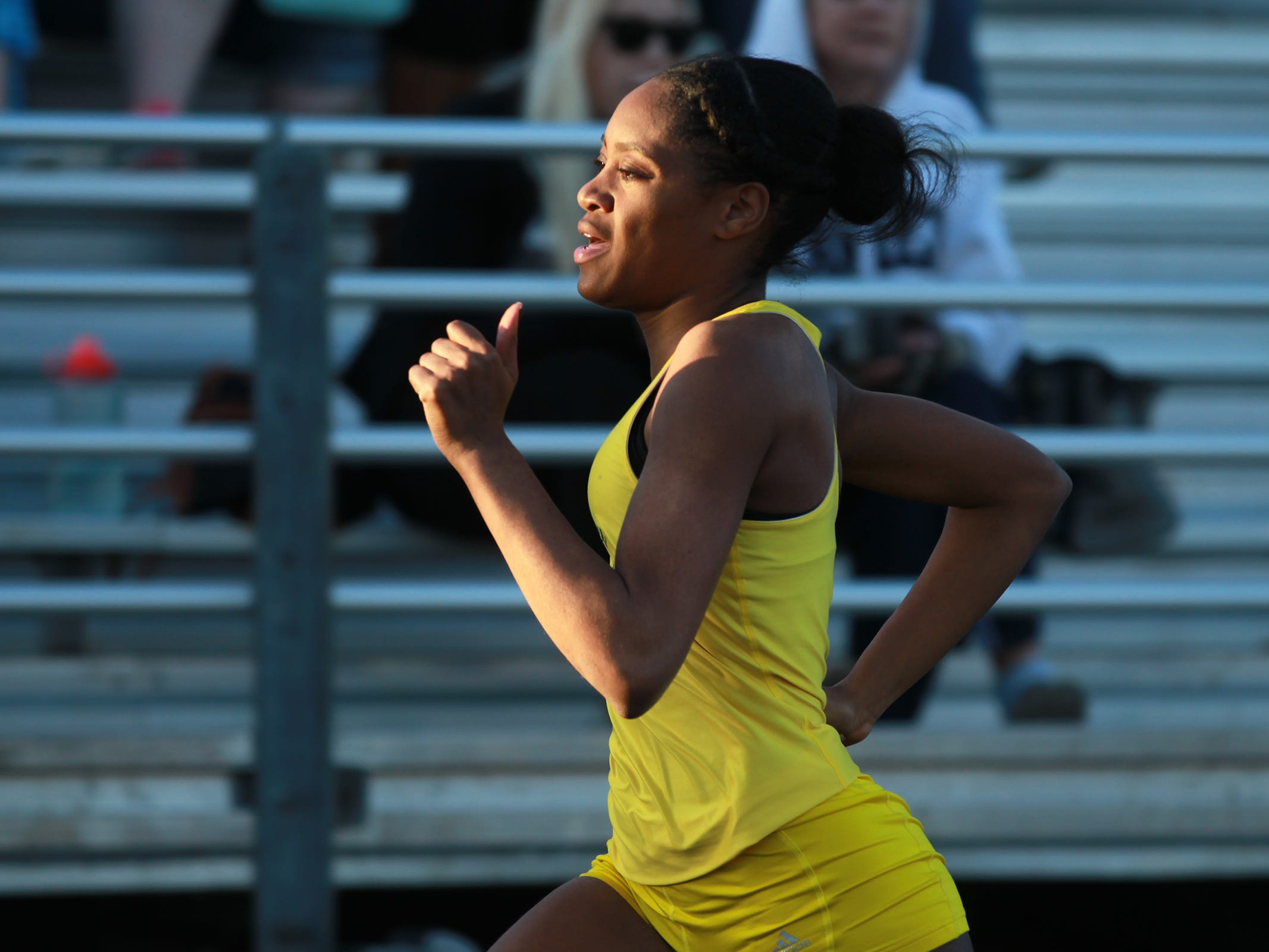 West High's Nia Basabe competes in the 200 meter dash at the Women of Troy Relays at West High on Tuesday, March 31, 2015. David Scrivner / Iowa City Press-Citizen