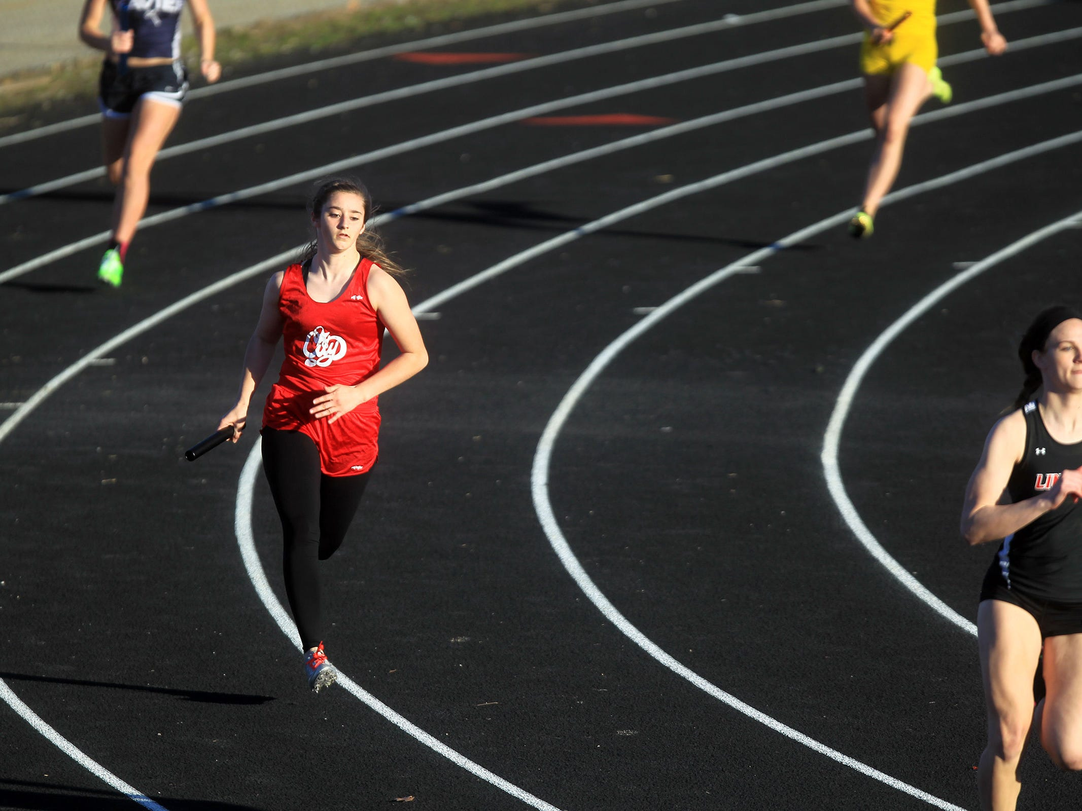 City High's Sara Blowers competes in the 4x200 meter relay at the Women of Troy Relays at West High on Tuesday, March 31, 2015. David Scrivner / Iowa City Press-Citizen