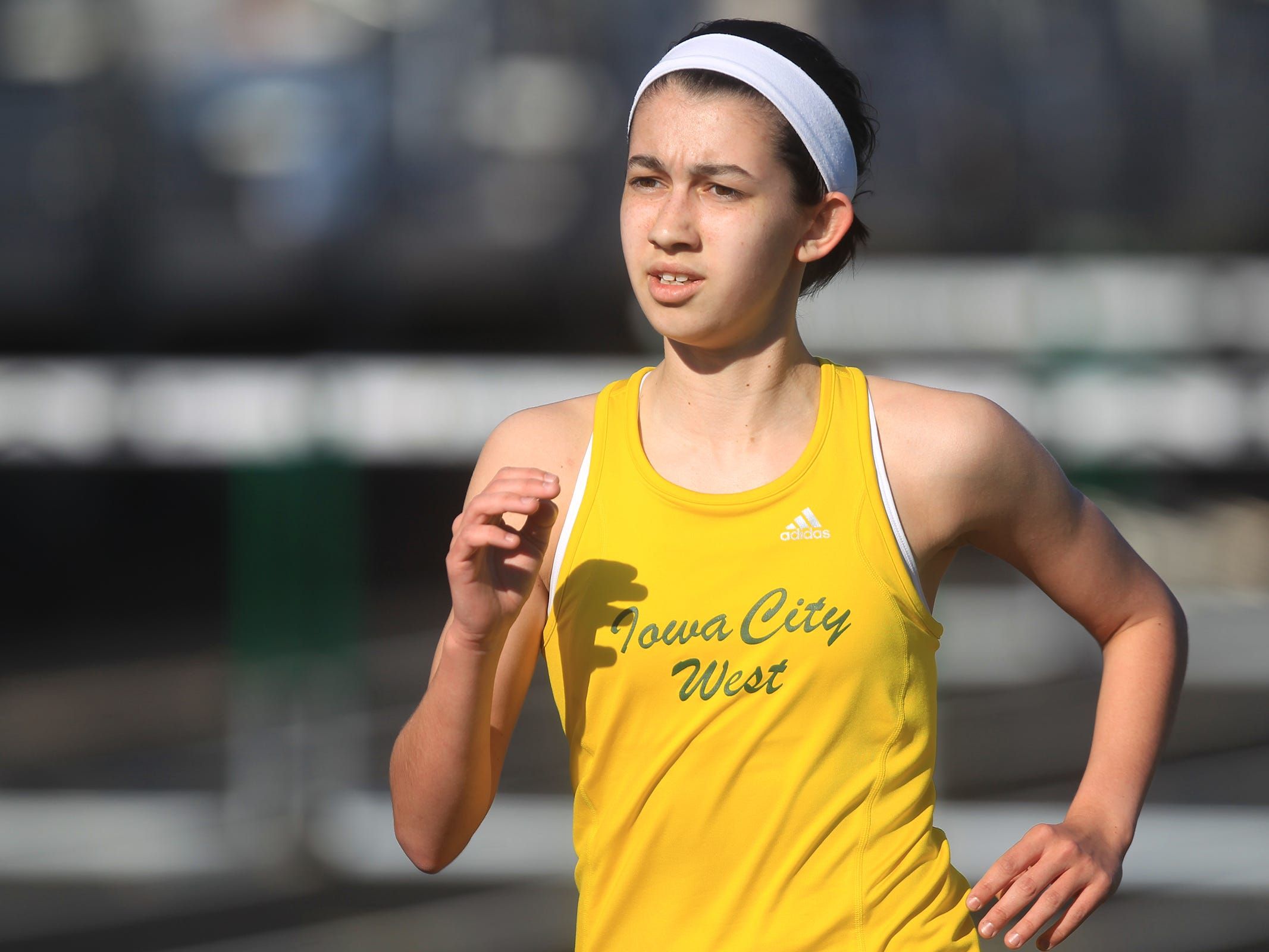 West High's Olivia Moore competes in the 3000 meter run at the Women of Troy Relays at West High on Tuesday, March 31, 2015. David Scrivner / Iowa City Press-Citizen