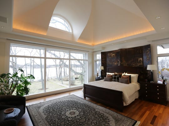 Master suite with his and hers marble bathrooms and dual dressing areas in this five bedrooms and nine bathrooms 7,072 Sq/ft. home set on an acre and a half on Upper Straits Lake in Orchard Lake, MI is for sale for $5,300,000 on Wednesday, December 17, 2014.
