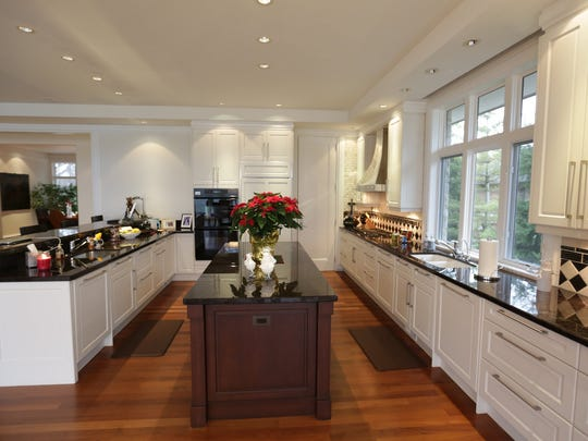 Gourmet kitchen featuring oversized granite island in this five bedrooms and nine bathrooms 7,072 Sq/ft. home set on an acre and a half on Upper Straits Lake in Orchard Lake, MI is for sale for $5,300,000 on Wednesday, December 17, 2014.