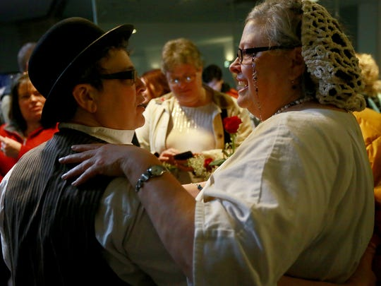 """Beth and Lisa Bashert of Ypsilanti embrace at their wedding at the Washtenaw County Clerk's office last year. """"The whole thing was magical,"""" Beth Bashert said."""