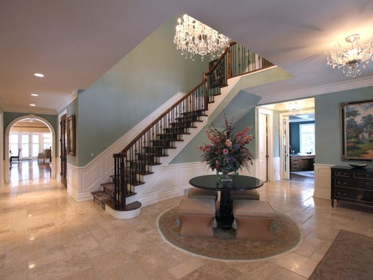 "Large foyer greets you at this elegant Birmingham residence built in 2003, on Lake Park Drive with large spacious rooms with lots of custom details. This home has 8 bedrooms 8.5 baths, many fireplaces, a Cedar wine room directly across from the dining room. The lower level is as intricately finished with a second full kitchen, Theatre room, home gym, and extra bedrooms. Outside there is a professional ""sport Court"", two terraces and a three car garage. Listed for $3,495,000. Picture taken March 31, 2015 by Jessica J. Trevino/Detroit Free Press"