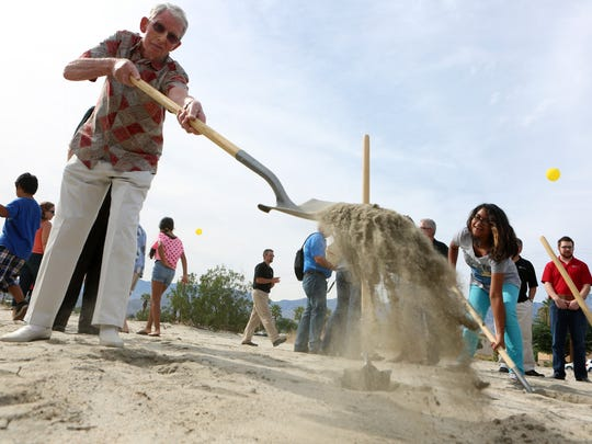 NorthGate Community Church long-time member Wally Cary of Palm Springs shovels dirt during the ground breaking ceremony for a new church building at the corner of 30th Avenue and Date Palm Drive in Cathedral City on October 26, 2014.