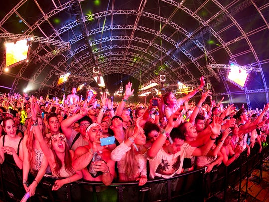 Electronic dance music fans watch Empire of the Sun perform in the Sahara tent during the Coachella Valley Music and Arts Festival's second weekend in April 2014. EDM has become a big part of the festival.