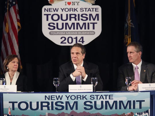 Gov. Andrew Cuomo, center, hosts New York's Second Tourism Summit at the American Museum of Natural History in New York Wednesday. To his left is Ellen Futter, and on his right is Lt. Gov. Robert Duffy.