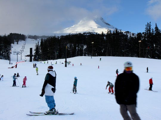 Families ski and snowboard at Mount Hood Meadows on Friday, Dec. 26, 2014. Friday is the first night of night skiing for the season and more snow is expected on Saturday.