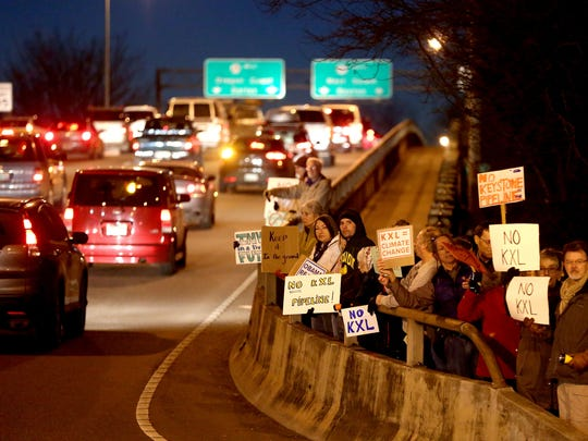 Climate activists rally in a nationwide day of action against the Keystone XL Pipeline at the Marion Street Bridge in Salem on Tuesday, Jan. 13, 2015.