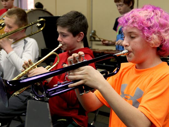 Sixth-grader Garrett Vancorbach, far right, plays trumpet during band class at Howard Street Charter School in Salem on Friday, Jan. 16, 2015.