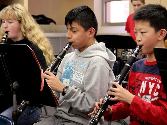 Clarinetists, from left, Paige Wylie, Camilo Hart and Matthew Zheng, all sixth-graders, practice at Howard Street Charter School in Salem on Friday, Jan. 16, 2015.