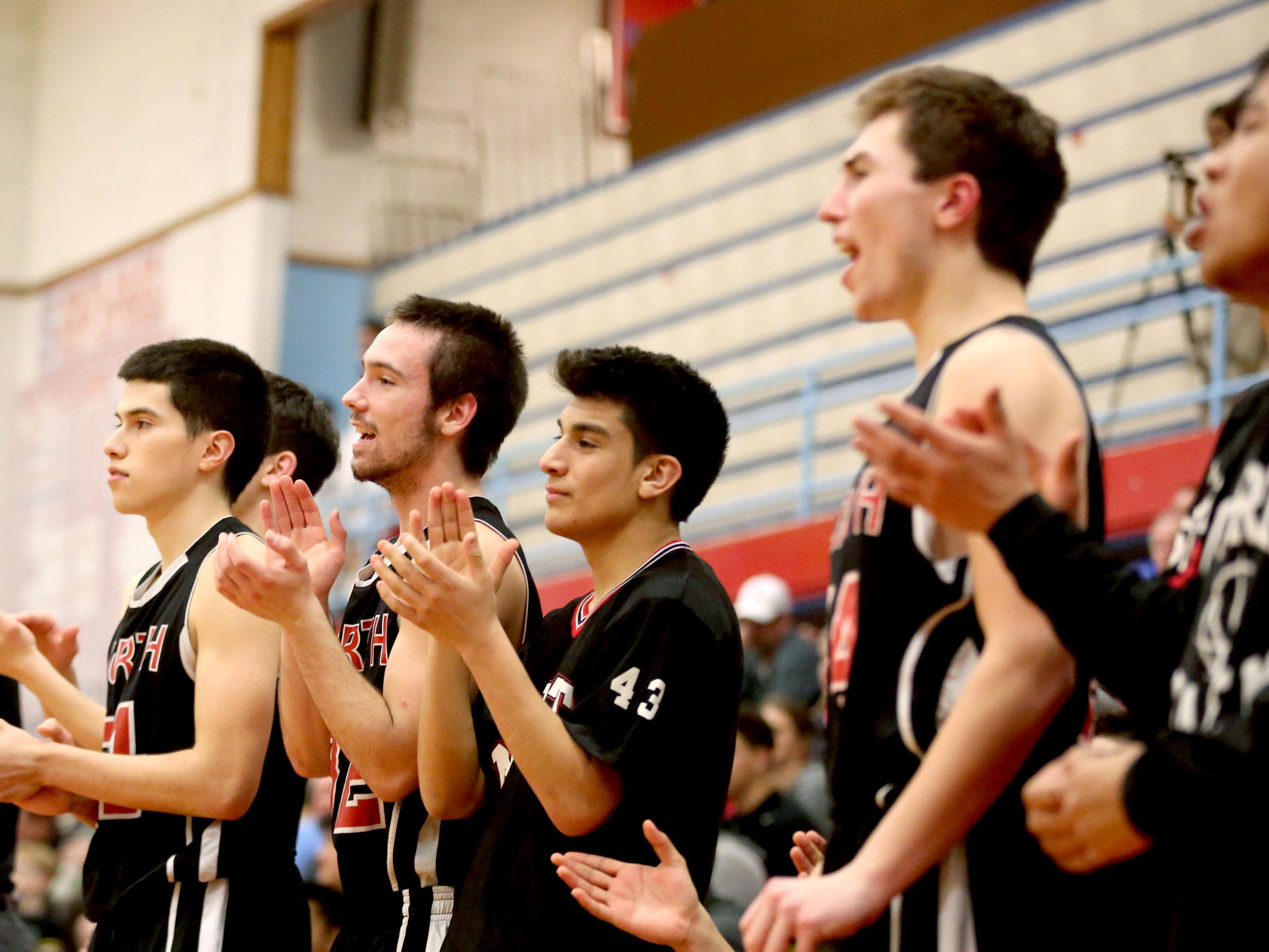 The North Salem bench celebrates a play in the first half.