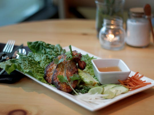 The pork belly lettuce wraps, served with lettuce, pickled vegetables and a sweet/spicy dipping sauce at Table 508.