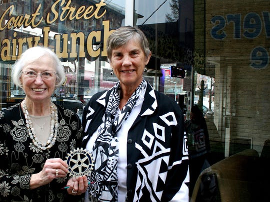 Mary Cooper, left, and Marilyn Schuster, hold a Rotary symbol acknowledging the Sunset Rotary's donation to women in Ghana. Their contribution bought a grist mill for the female farmers.