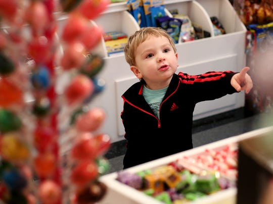 Evan Good, 3, of Salem, looks through candies at Ricky's Bubbles & Sweets Shoppe in downtown Salem.