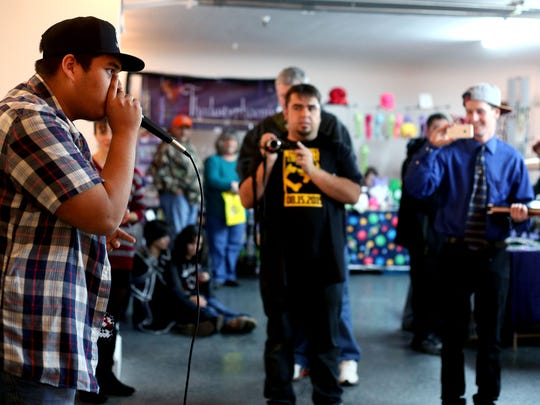 Beatboxer Robotic Torres (far left) performs during an arts and crafts fair for the February First Wednesday event at the Salem Arts Building in Salem on Wednesday, Feb. 4, 2015.