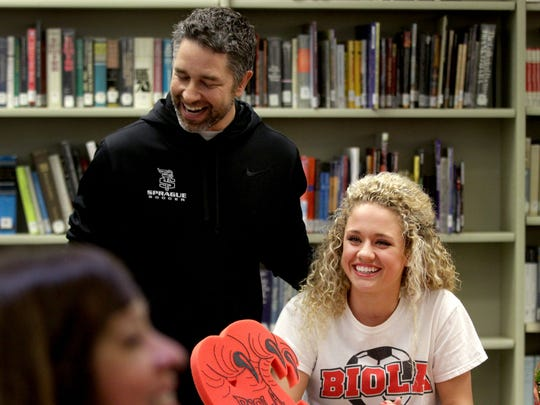 Sprague High School girl's soccer coach Kevin Plechl speaks about player Madyson Brown before she signs a letter of intent to play for Biola University during the 2015 National Signing Day ceremony at Sprague High School in Salem on Wednesday, Feb. 4, 2015.