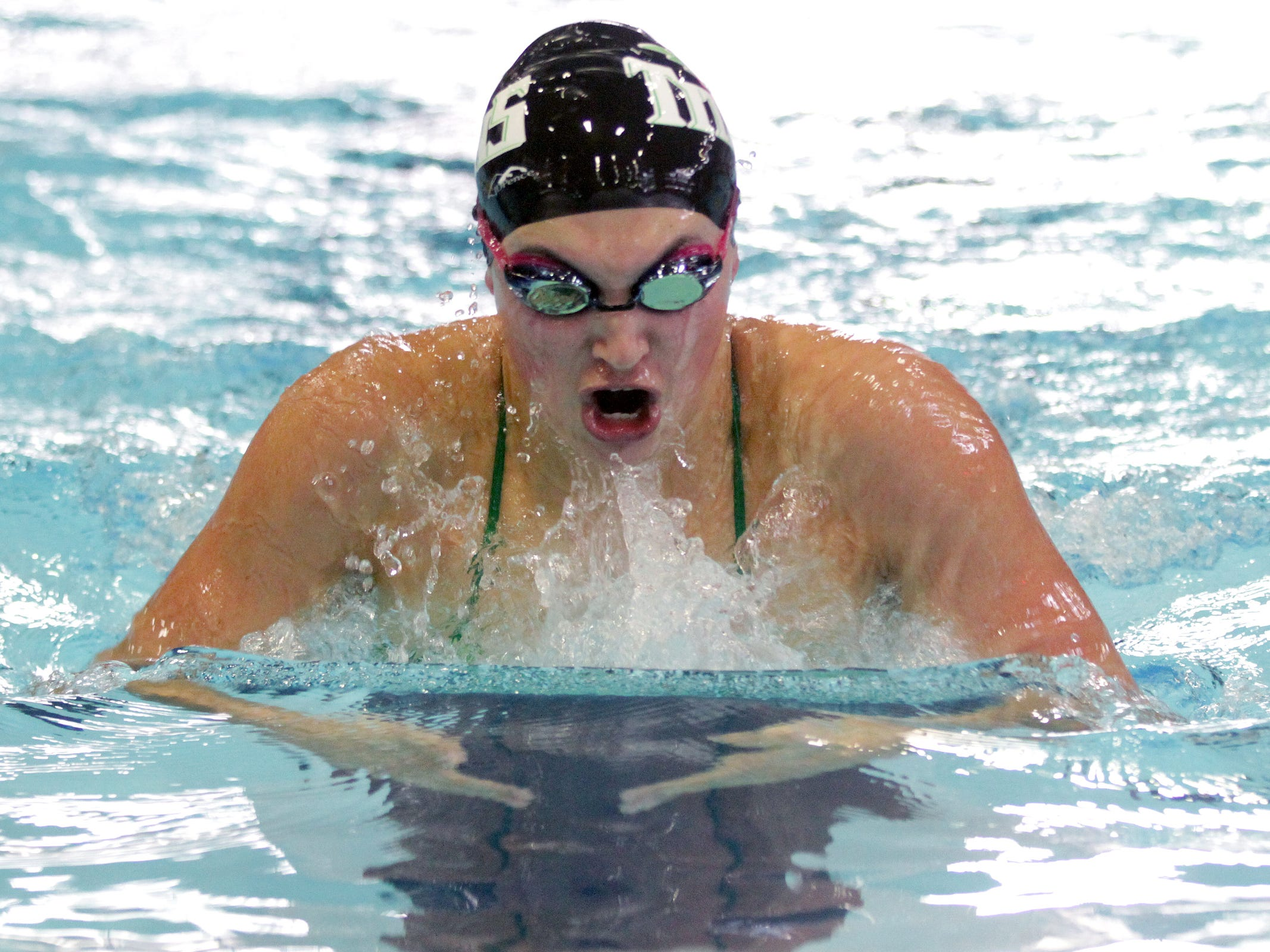 West Salem senior Mackenzie Rumrill competes in the 200 yard individual medley on the first day of the Greater Valley Conference high school swim meet at the McMinnville Aquatic Center on Friday, Feb. 13, 2015.