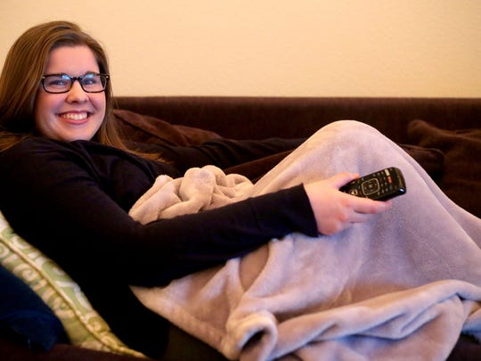 Statesman Journal reporter Kaellen Hessel watches a movie in her Salem apartment.