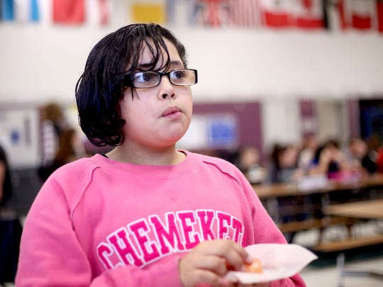 Jaleaha Wright, a sixth-grader, tries a red beet during the lunch period at Leslie Middle School in Salem on Thursday, Feb. 19, 2015. A cooperation with FoodCorps, the Salem-Keizer Education Foundation, and LifeSource Natural Foods gives students to opportunity to try potentially new fruits and vegetables during their lunch period.