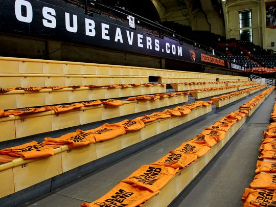 "Complimentary shirts and signs wait for Beavers fans before the start of the Oregon vs. Oregon State ""Civil War"" men's basketball game in Corvallis on Wednesday, March 4, 2015."