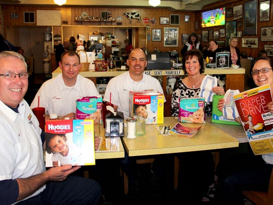 "Employees of Les Schwab Tires and Oak Park Dental inflated the Court Street Dairy Lunch dining room Tuesday. They showed up to generate interest in their annual diaper drive for Family Building Blocks. Sitting around the table from left, are: Lyle Mordhorst, Jeremy McCart, Brian Burnside, Lee Ann O""Leary and Julie Hilty."