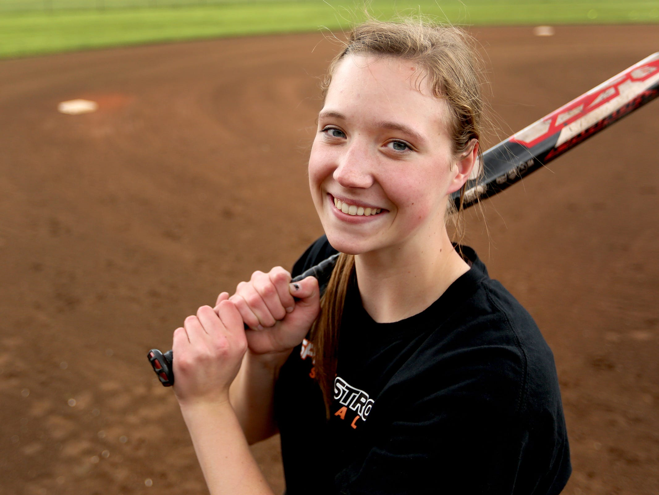 Senior catcher Jessie Isham at Sprague High School on Monday, April 6, 2015. She has committed to play softball for Minnesota.