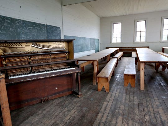 A broken piano, tables and benches are inside an abandoned schoolhouse that stands in the remains of Friend, just east of the Cascades. The school was built in 1909 and closed in 1942.