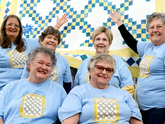 """Back row, from left, Pam Valley, Sheila Powell, Jan Minten and Dianne Nordyke, and front, Leslie Coleman Zeigen and Jeanette Spellmeyer, are all members of the Mid-Valley Quilt Guild, which was promoting its upcoming """"Threads of Friendship"""" biennial quilt show at the Polk County Fairgrounds."""