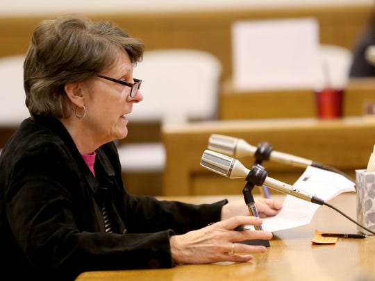 Marge Easley, of the League of Women Voters of Oregon, speaks during a meeting of the House Committee on Rules on Senate Bill 941, which would require background checks for private gun sales and transfers, at the Oregon State Capitol in Salem on Wednesday, April 22, 2015.