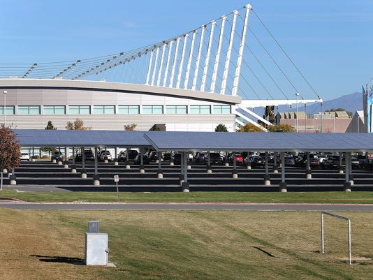 Solar array project of panels built on top of the parking cover outside of the Utah Olympic Oval with creates enough power to take over 500 homes off the power grid Thursday, Oct. 30, 2014, in Kearns.  (AP Photo/The Deseret News, Tom Smart, Deseret News)