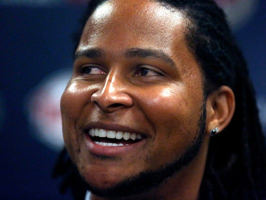 In this Dec. 13, 2014 photo, new Minnesota Twins pitcher Ervin Santana is introduced during a baseball news conference in Minneapolis. (AP Photo/The Star Tribune, Jim Gehrz)