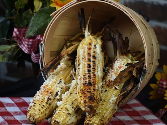 Grilled corn at the BBQ, Brews & Blues Festival is dusted with queso fresco and pequin chile powder.