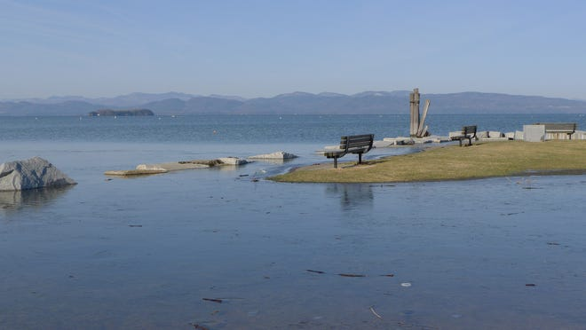 The benches at the tip of the park at Perkins Pier in Burlington are surrounded by lake water Thursday morning (April 17, 2014) as Lake Champlain rises above flood stage. Juniper Island can be seen offshore. The USGA reported the lake level at 100.25 ft as of 9 a.m.